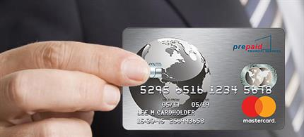 person holding up a mastercard credit card