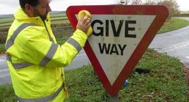 Upton Pyne self help - sign cleaning