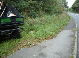 flail cutting along pavement into Knowle