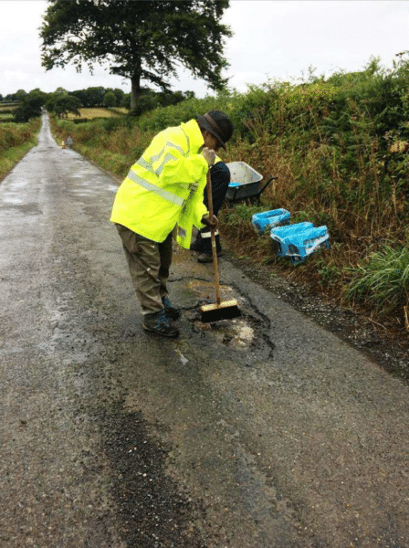 preparing a pothole for filling with the PPR
