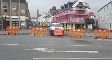 road closed sign at road in bideford with road closure barriers