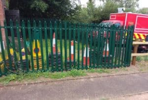 traffic cones stacked behind railings
