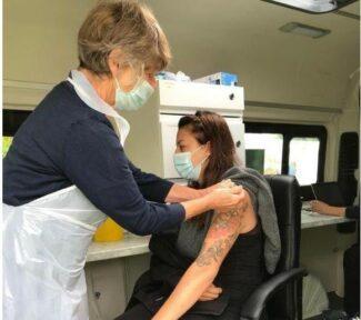 person getting a COVID-19 vaccine