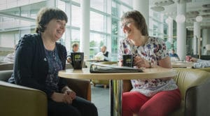 Mary Sherwood pictured with fellow dementia carer in Met Office canteen