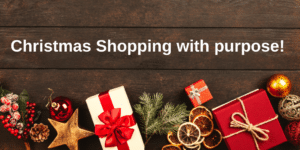 Image of Christmas parcels and decorations with the title 'Christmas Shopping with purpose!'