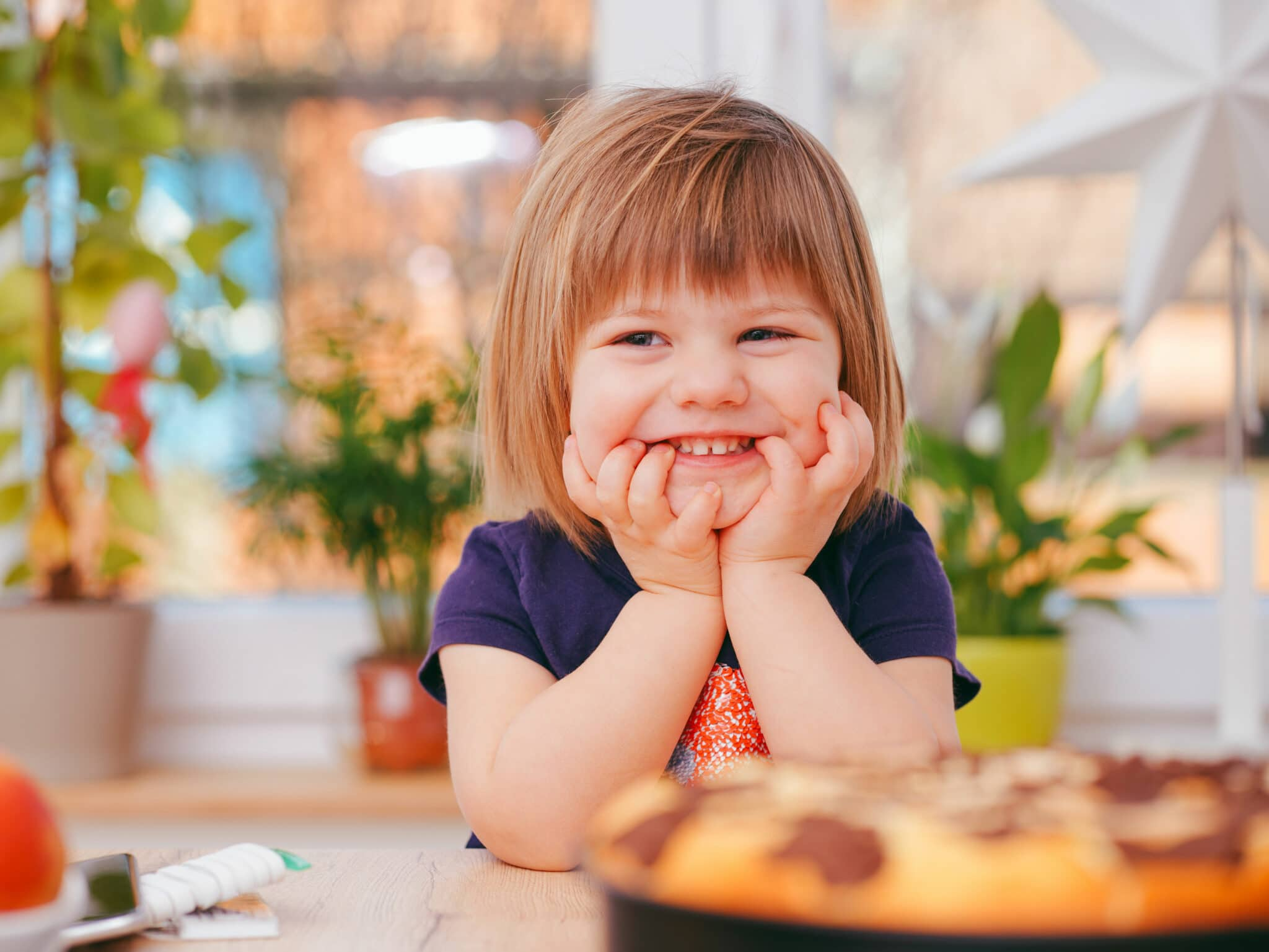 Girl sitting at a table with food