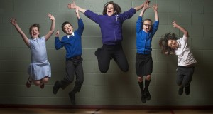 a group of children jumping in the air