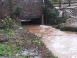 High flowing water under culvert