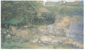 Installation of gabions on an eroding bank wall