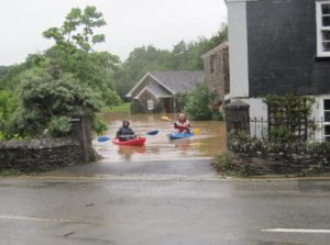Photo of residents in floods at Tree Corner