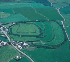 An aerial photograph showing the multiple ramparts of Clovelly Dykes hillfort as earthen banks and hedges.