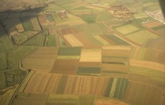 A colour aerial photograph showing the various strips of unenclosed fields in the surviving medieval open field system known as Braunton Great Field