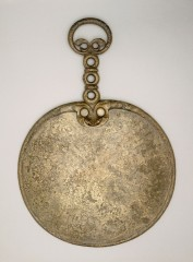 Iron Age bronze mirror from Holcombe, East Devon. Photo: © The Trustees of the British Museum.