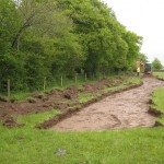 Topsoil stripping being monitored by an archaeologist