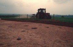 Buried archaeological features may be invisible on the surface. The pits and postholes of this Iron Age settlement near Exeter were discovered when topsoil was stripped for the new A30.