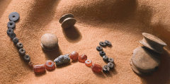 Beads and ear studs, just part of the most important assemblage of prehistoric grave goods to be found on Dartmoor (Photo. Gary Young © Dartmoor National Park Authority