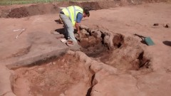 One of several grain drying ovens under excavation. Photo: Cotswold Archaeology