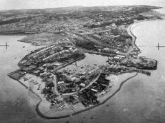 Anti-invasion barbed wire apron crossing the estuarine silts around the docks at The Point, Exmouth. NMR SX 9980/17 MSO 31241/46 14-AUG-41. Historic England (RAF Photography).