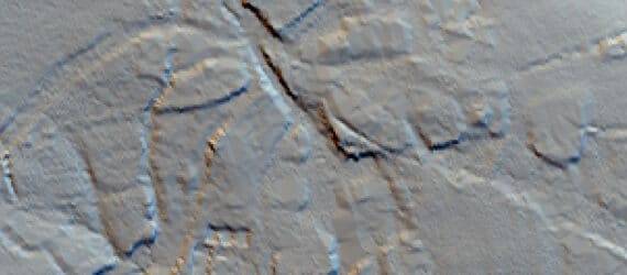 Greyscale lidar imagery showing raised areas either side of incised roadways.