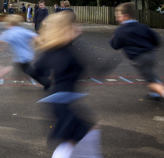 blurred picture of children playing in the play ground