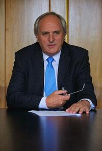 Councillor John Hart sat at his desk