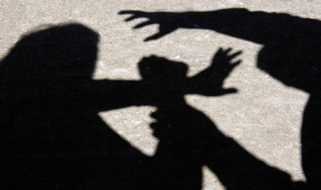shadows of two people fighting