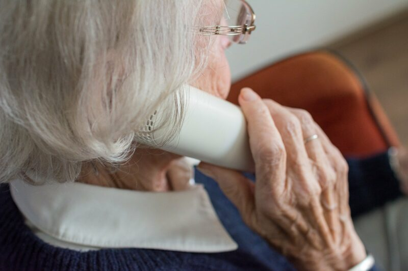 elderly lady holding a phone to her ear