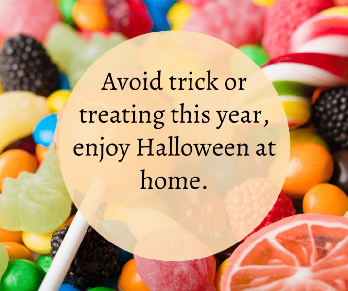 """Sweets, with the words """"Avoid trick or treating this year, enjoy Halloween at home"""""""