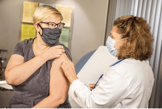 A lady receiving her vaccination