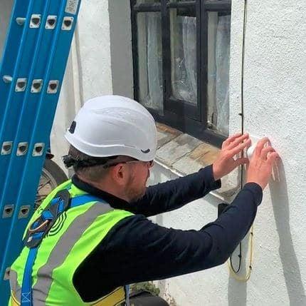 Photo of Airband engineer installing fibre broadband