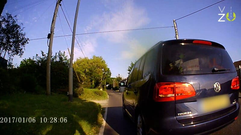 Photo of a car dangerously overtaking a cyclist