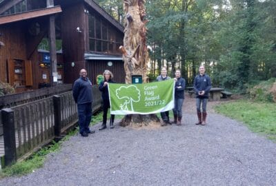 Photo of Stover Country Park staff with the Green Flag Award