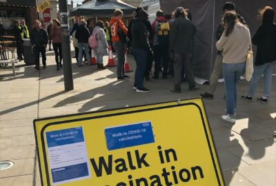 Queue of people waiting to receive their vaccination at the pop-up vaccination unit in Queen Street, Exeter