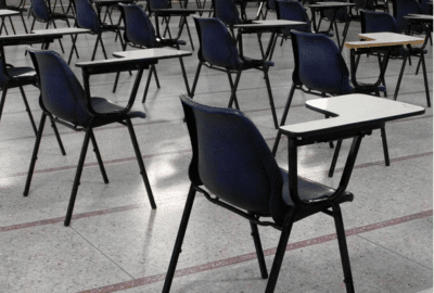 School chairs with tables in a hall