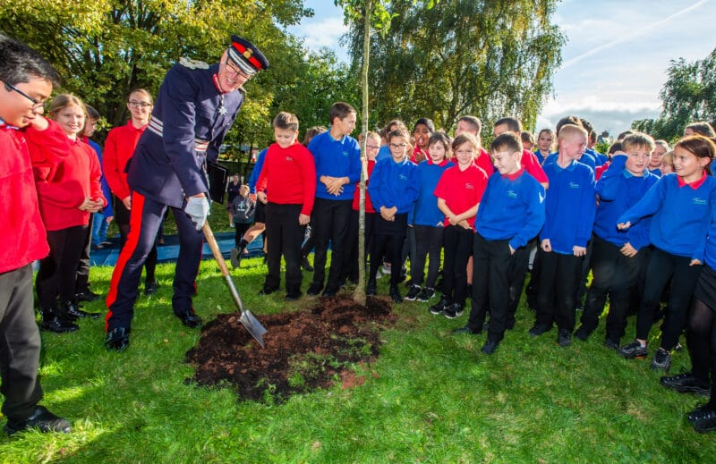 Lord Lieutenant with school children and a tree