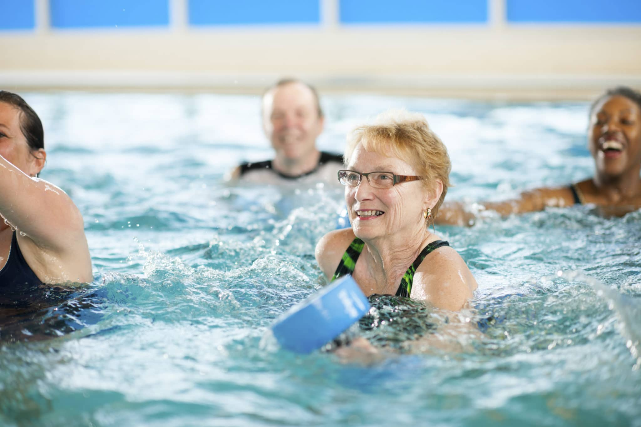 People doing exercises in a swimming pool