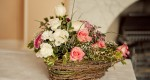 Basket of flowers at a civil ceremony at Larkbeare House.