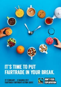 Fair Trade Fortnight 27 Febraury to 12 March 2017, it's time to put fairtrade in your break, image of mugs full of various fair trade food and drink in shape of a clock face with spoons in the middle symbolising the hands of the clock