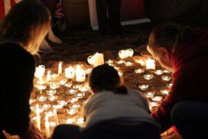 People sat looking at candels