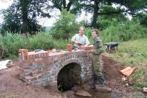 Waterway Recovery Group volunteers repairing brickwork on a culvert