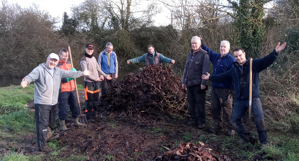 Volunteers creating a grass snake egg-laying heap at Ebear Pond