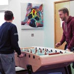 two young people playing table football
