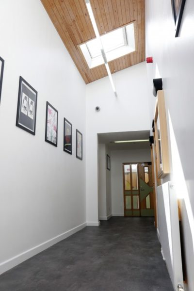 corridor with pictures on the wall