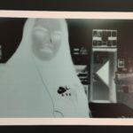 a photo negative of a woman