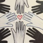 reach for the heart art work with hands reaching for a heart in the centre