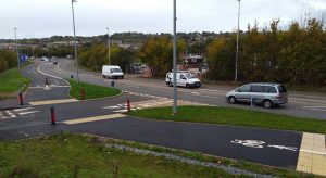 Bidirectional (two way) cycle route along Cumberland Way at Monkerton showing a priority crossing for pedestrians and cyclists.