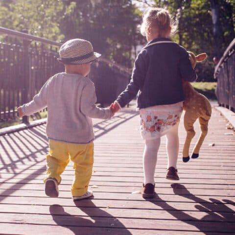 children running holding hands (Devon's SEND Local Offer)