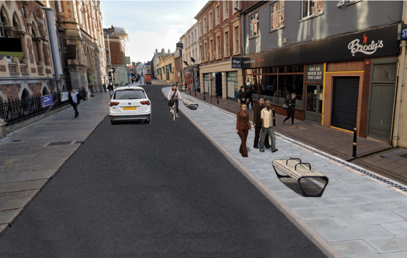 Visualisation of Queen St, with wider footway and street furniture (benches/planters) on southern side and vehicle carriageway wide enough for a car to pass a cyclist.