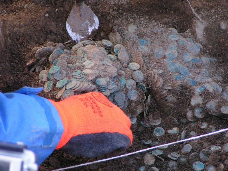AC Archaeology excavating the coin hoard. © Devon County Council