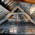 Former Rose and Crown, Barnstaple. One of surviving 16th or 17th century cruck trusses in roof (looking E, 2 x 1m scales). Copyright COAS Ltd.